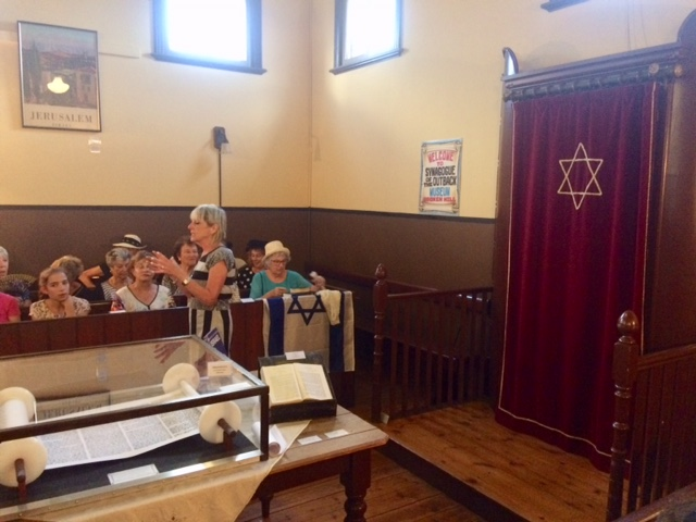 Women from the Ark Centre in Melbourne sitting in the womens' section of the Broken Hill Synagogue